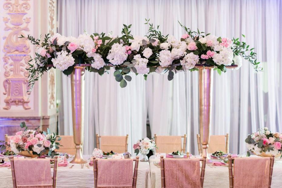 Reception table with floral arbor