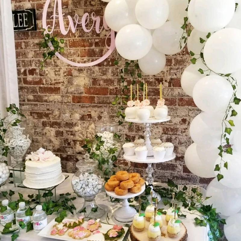 Garden Theme Bridal Shower Dessert Table with white wedding details... cake stands & balloon garland!