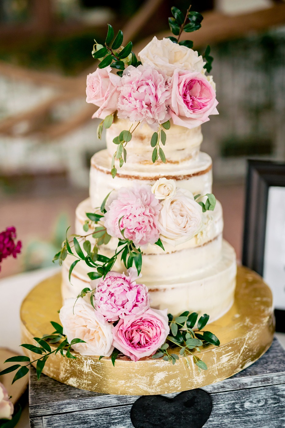 soft pink floral topped wedding cake