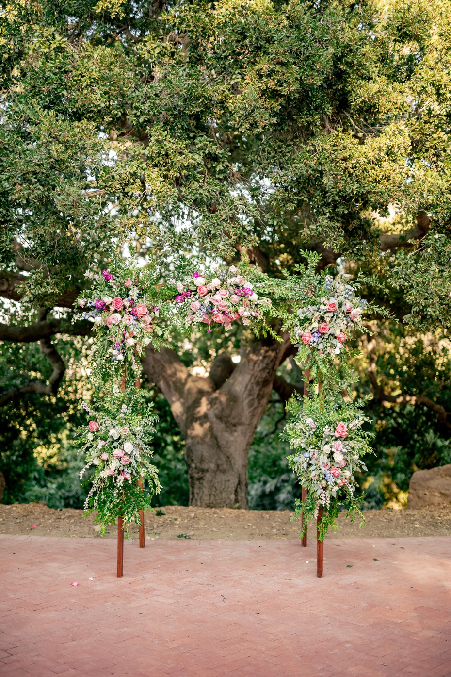 floral draped wedding arch