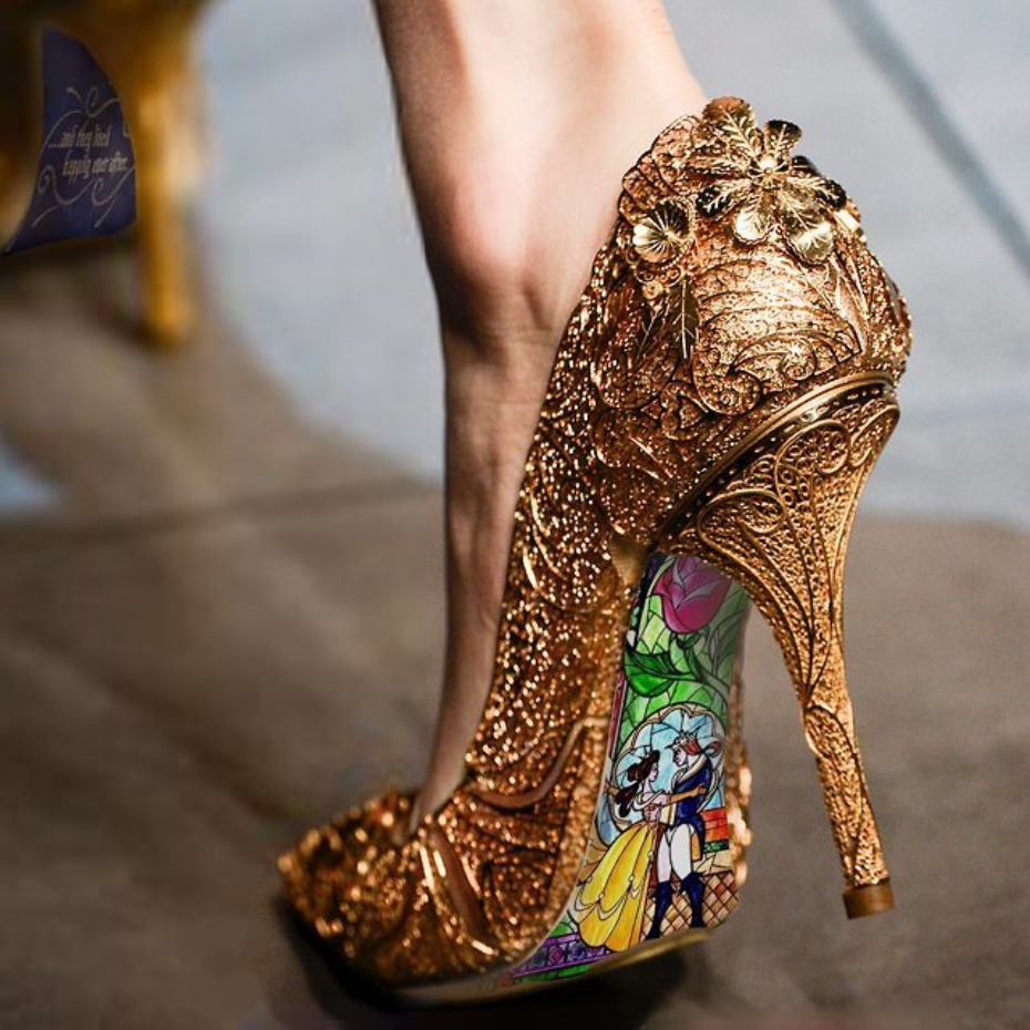 gold shoes hand painted with Beauty and The Beast on the back