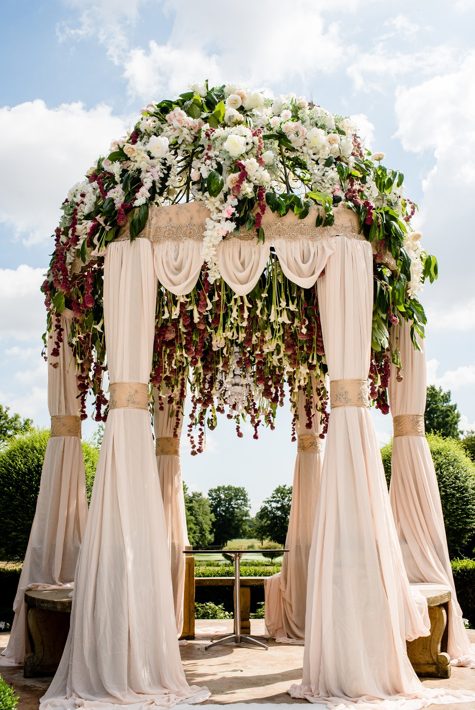 Floral covered wedding arch