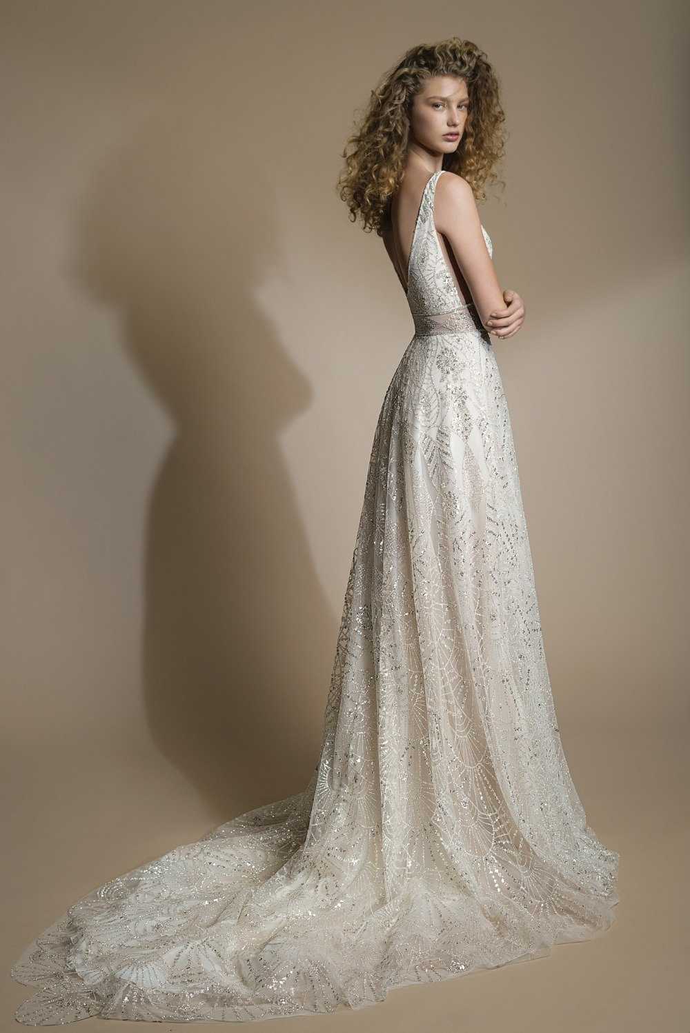 shimmering sequined tulle with a striking Galia Lahav wedding dress with a geometric silver patter over a nude background