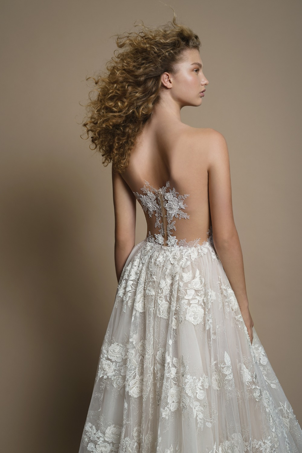 Elaborate lace ballgown featuring a sheer corset with a sheer back from Galia Lahav