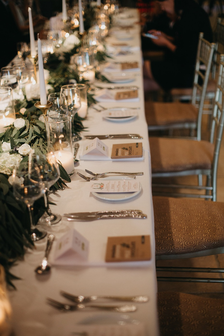 Green and white table decor with candles