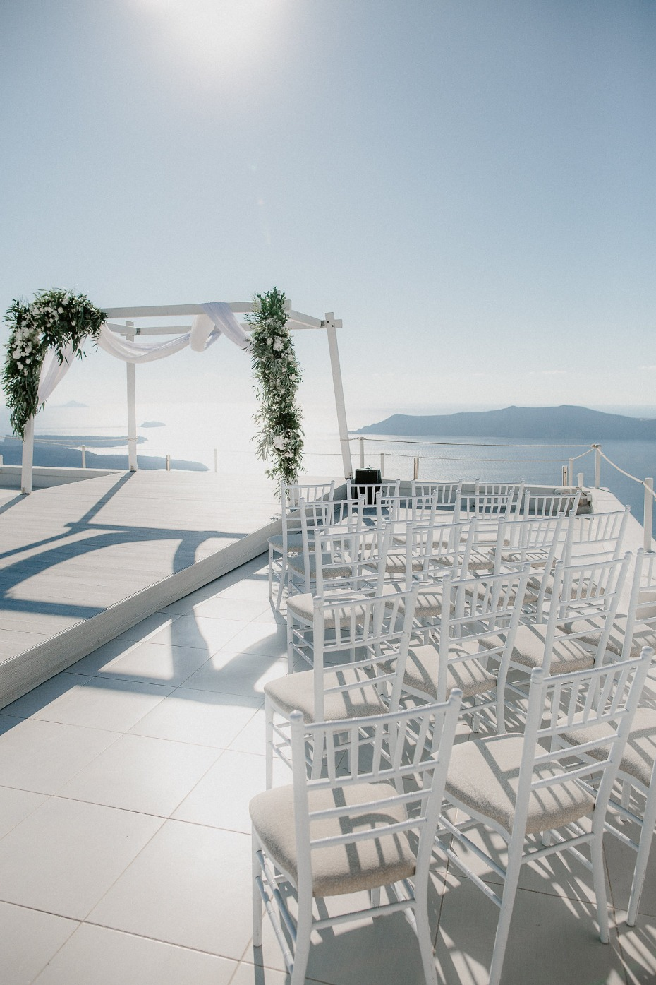 White ceremony with greenery
