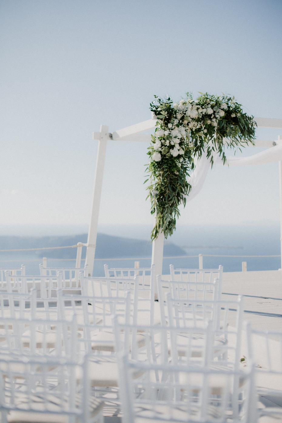 Simple wedding arch and greenery