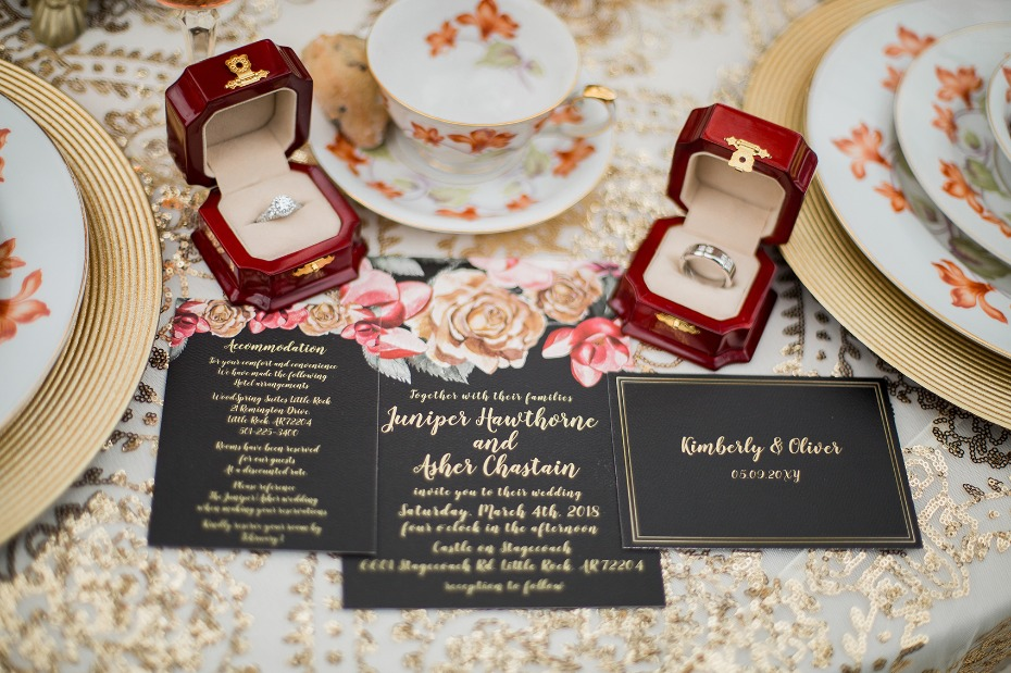 Black and gold invitation suite with florals