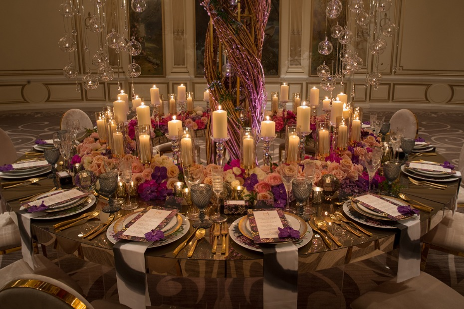 candle lit wedding table with pink and purple glam decor