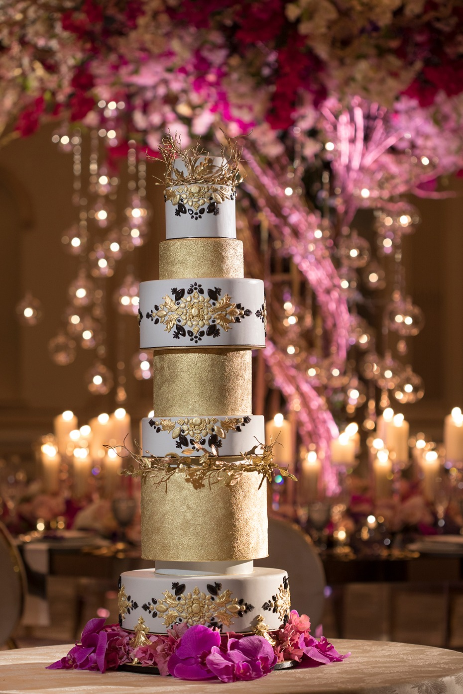 gold and black and white wedding cake