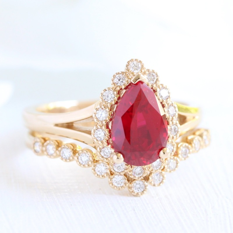 Vintage Inspired Bridal Set of Pear shaped Ruby Engagement Ring in Vintage Halo and split shank design paired beautifully with a Curved