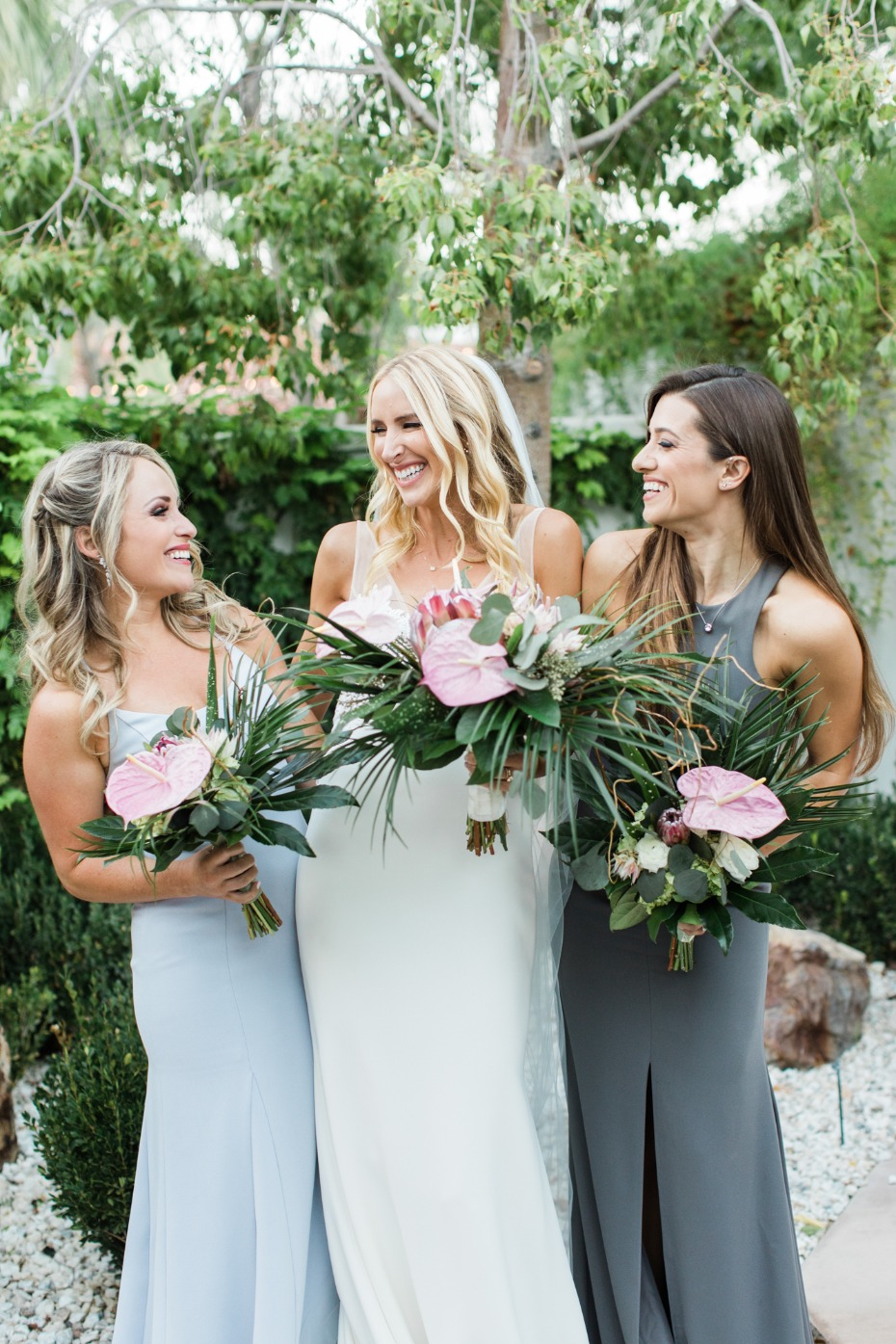 Bridesmaids in blue and grey
