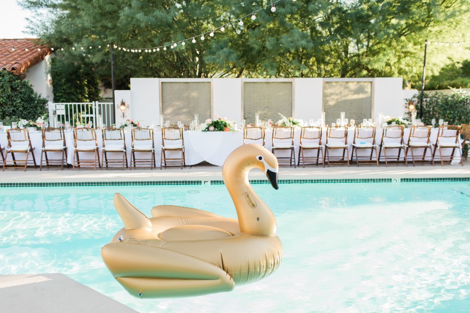 Giant gold swan for a chic poolside reception