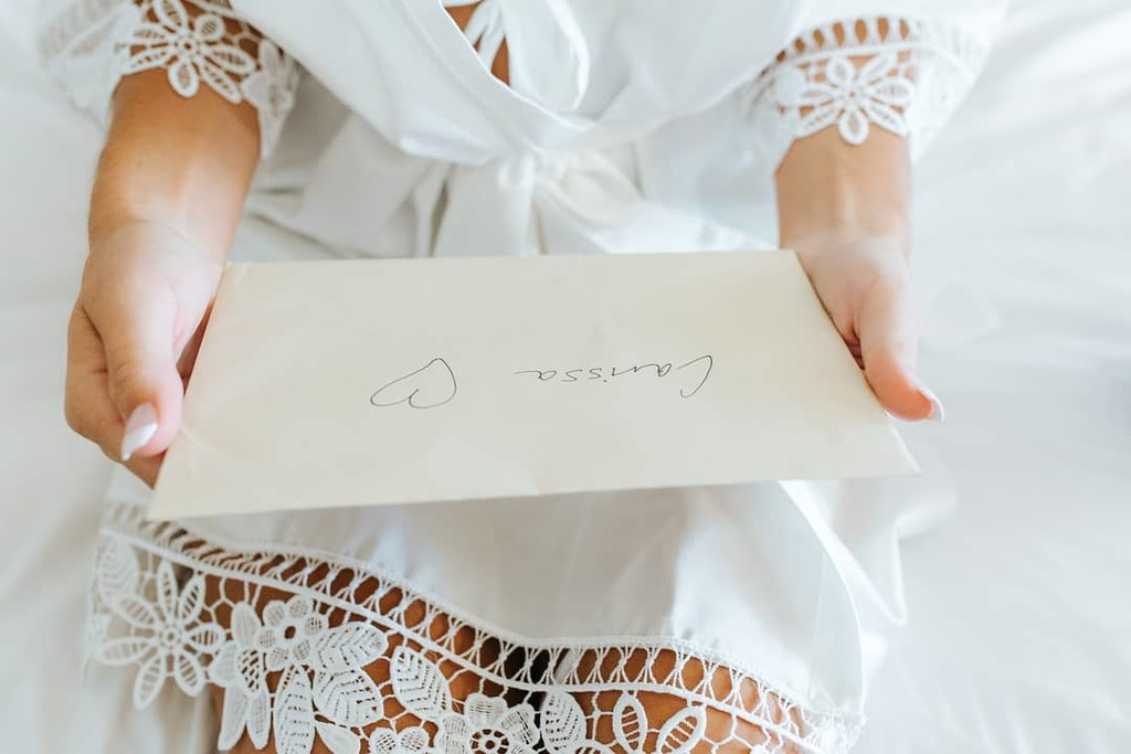When his love letter arrives 💌 Carissa opening her man's wedding letter in her 'Lauren' robe. Who else thinks this is one of the