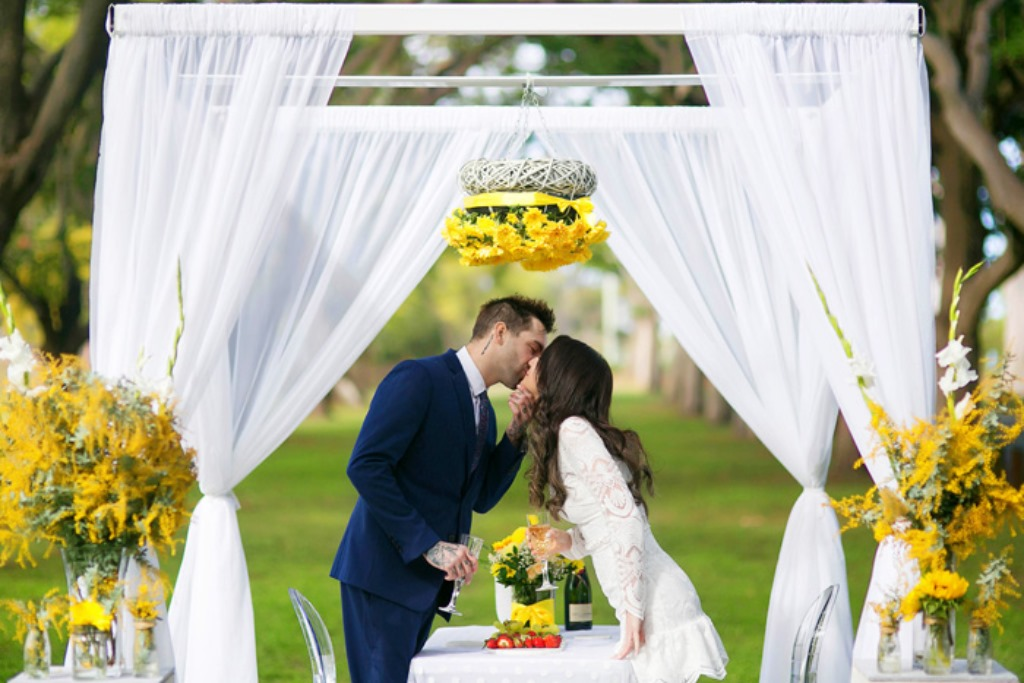 An elegant arbour styled with an abundance of yellow florals by Brisbane Wedding Decorators. https://www.brisbaneweddingdecorators