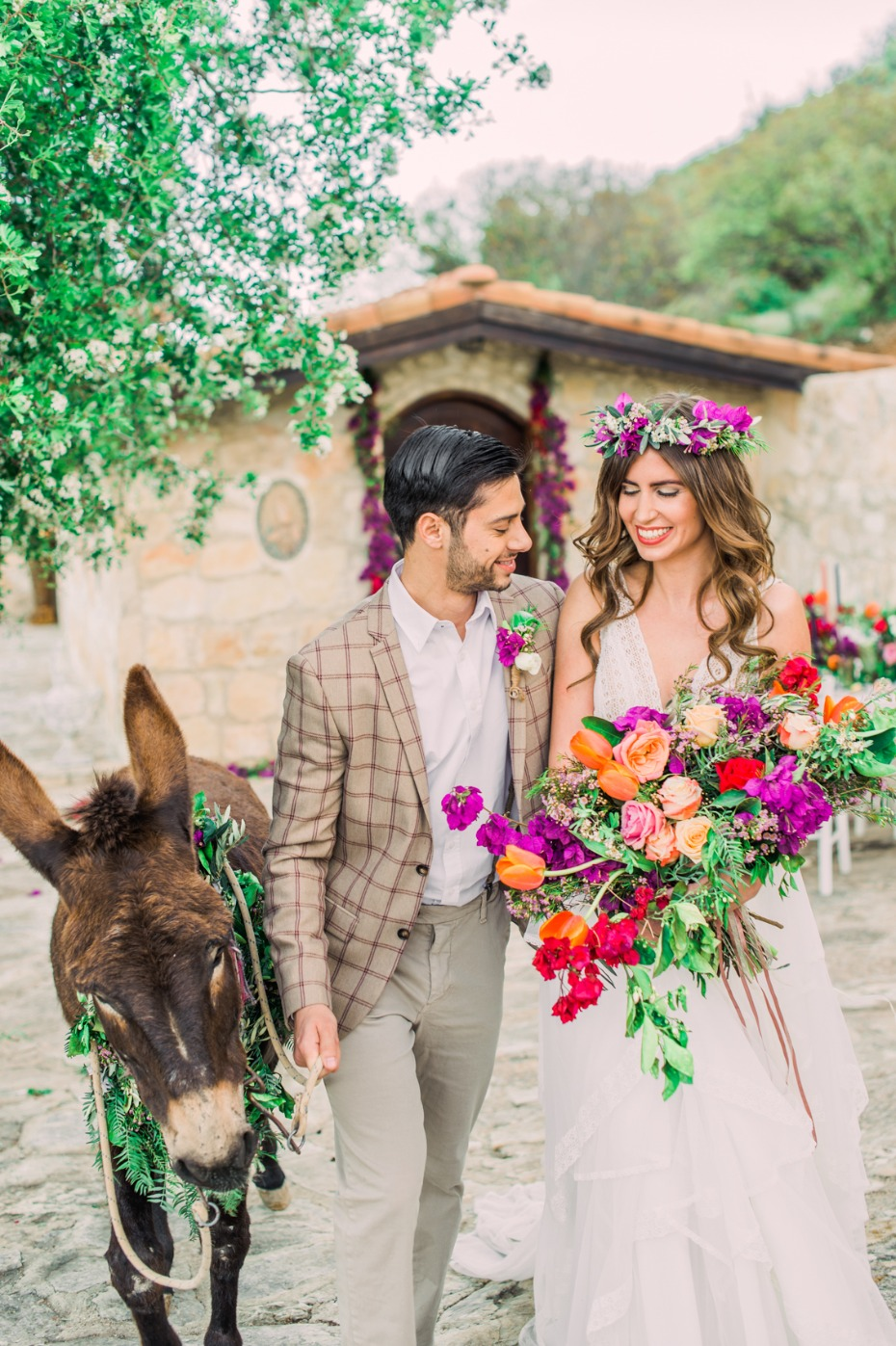 Colorful boho wedding with a donkey