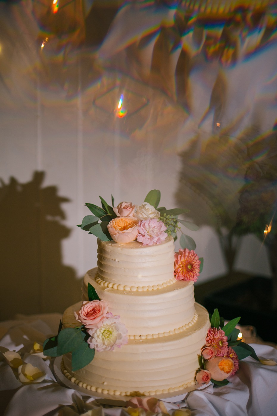 Wedding cake covered in flowers