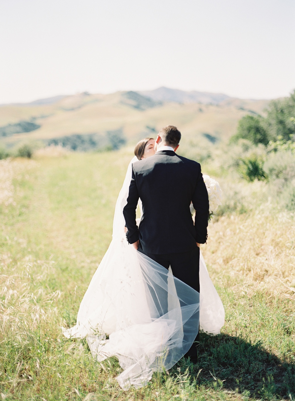 A Formal Floral Wedding in Santa Ynez Wine Country featuring a stunning Carolina Herrera Wedding Gown and valley views for days.