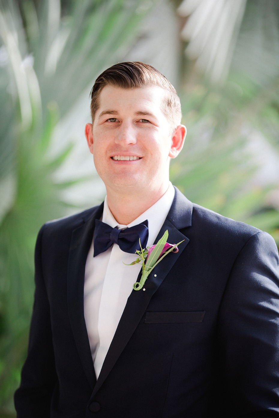 groom in classic suit and bow tie