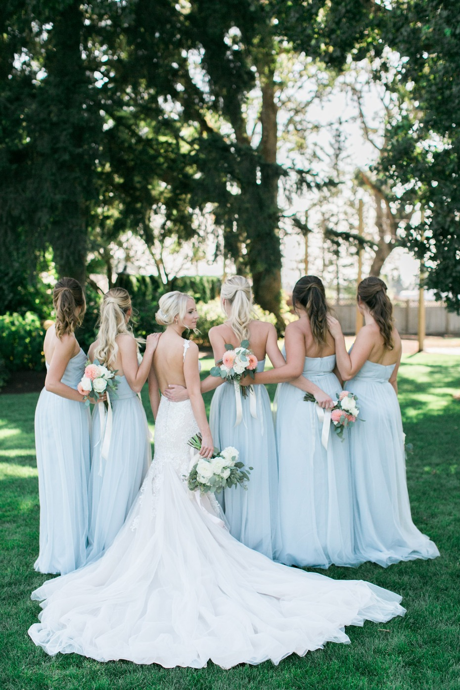 Bridesmaids in matching blue gowns