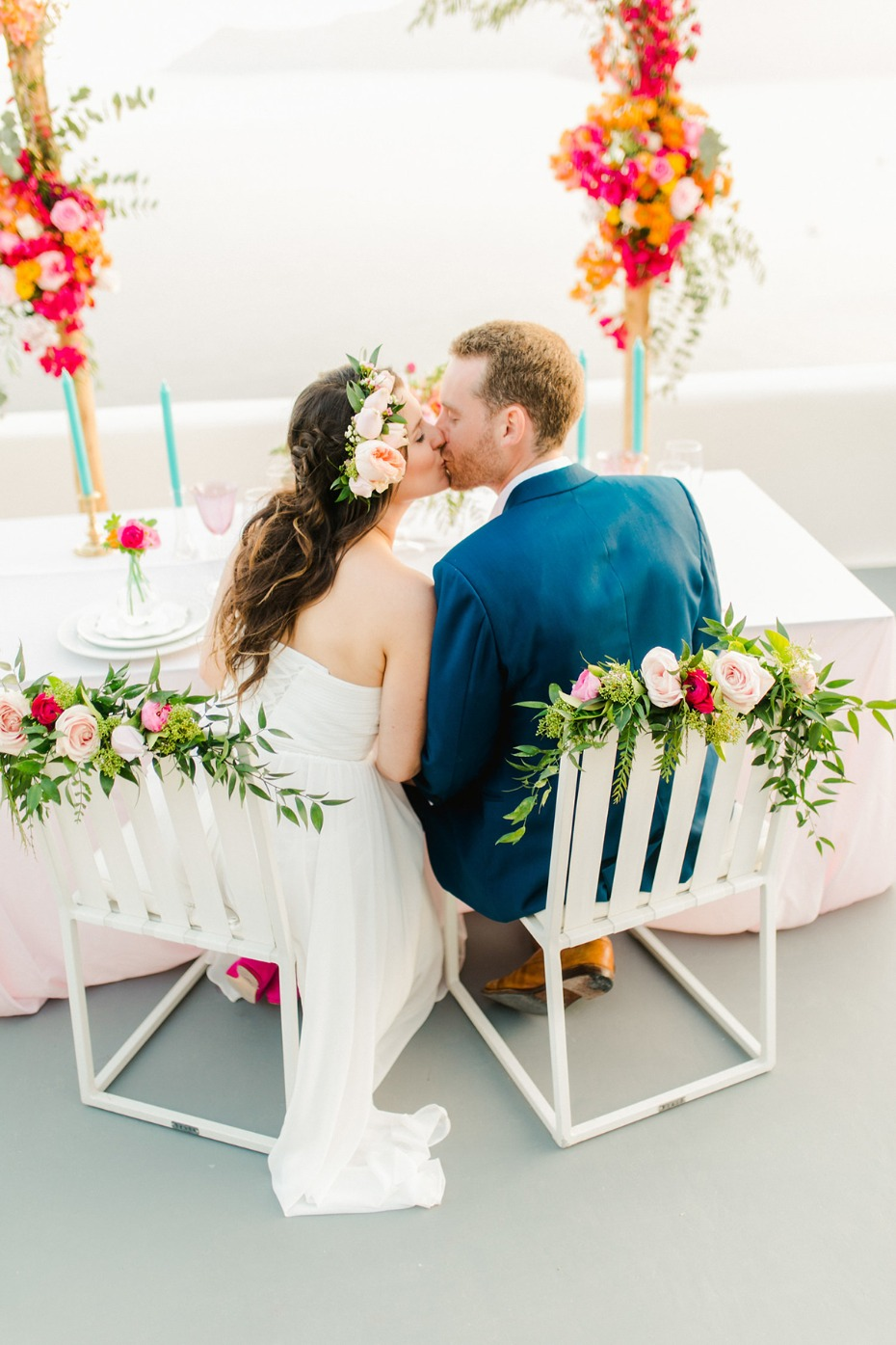 wedding kiss and flower seat accents