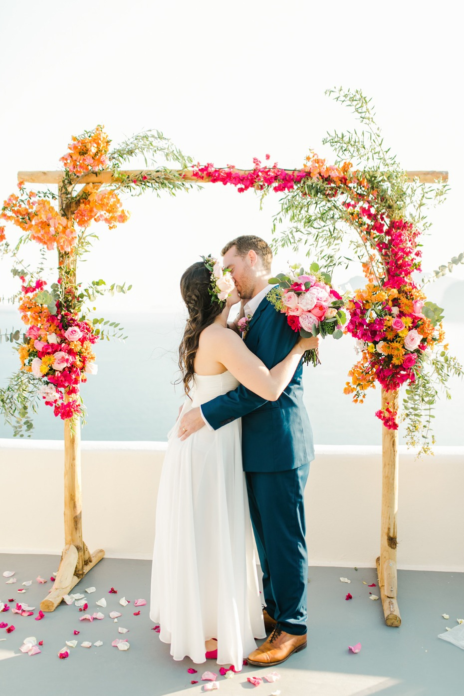 orange and pink floral wedding arch