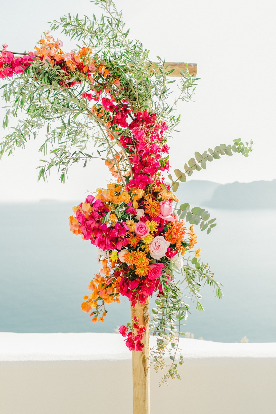 hot pink and orange wedding arch