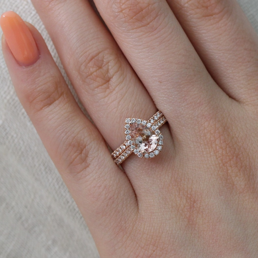 Classic Bridal Set of Pear Shaped Morganite Halo Engagement Ring with Pave Diamond Band paired with a Matching Diamond Wedding Band