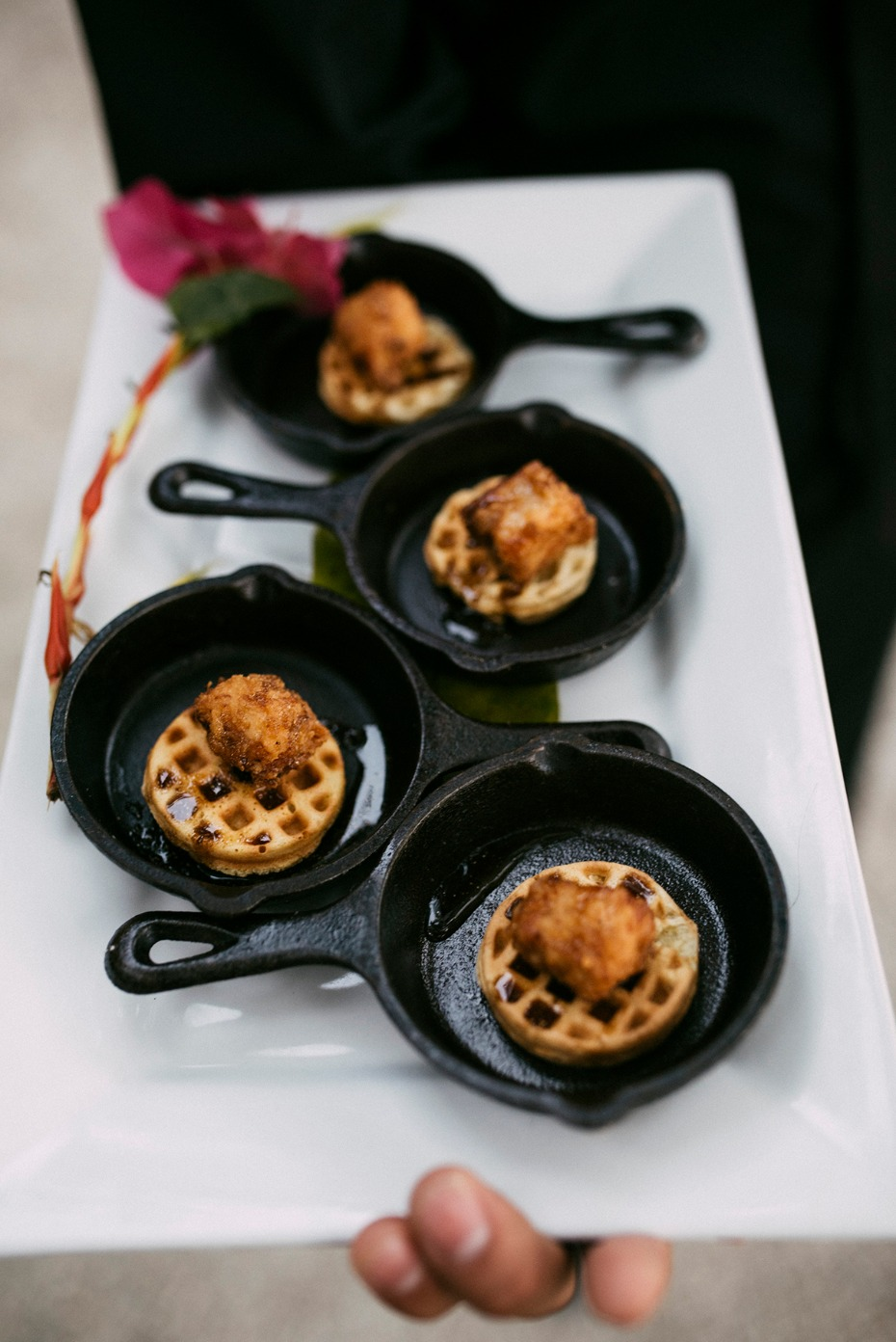 mini chicken and waffles in cast iron skillets