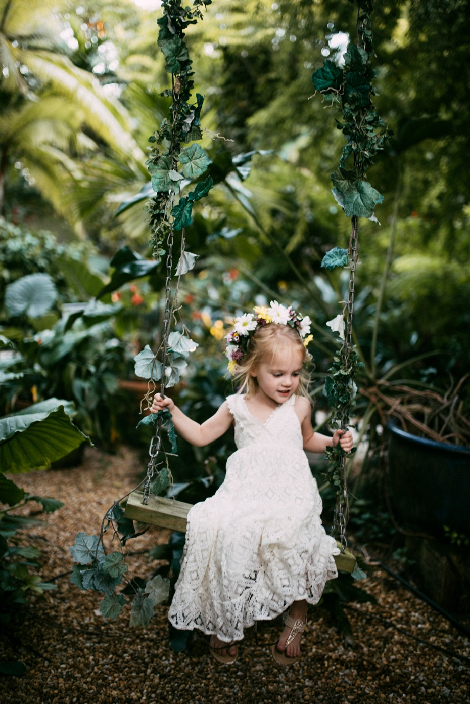 cute little flower girl on a swing