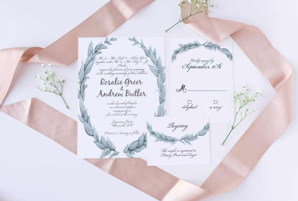 A romantic border can really set the tone for your wedding invitations like this leafy love wedding suite. Pair it with some other