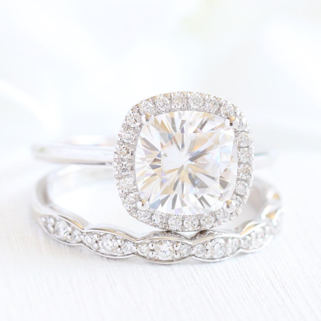 Classic Bridal Set of Cushion Moissanite Diamond Halo Engagement Ring with Pave Diamond Band paired with a Scalloped Diamond Wedding