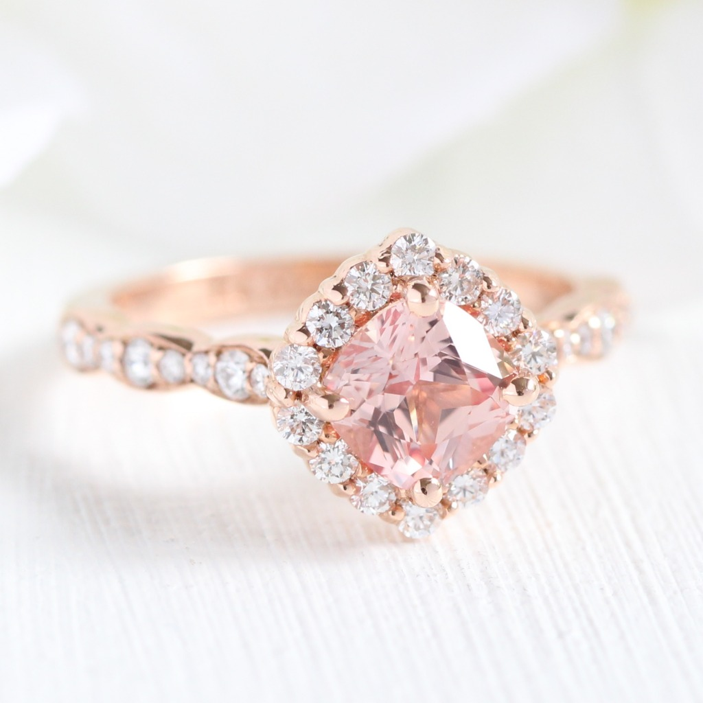 Delicate beauty ~ Cushion Champagne Peach Sapphire Engagement Ring surrounded by a halo of diamonds in a scalloped diamond band in