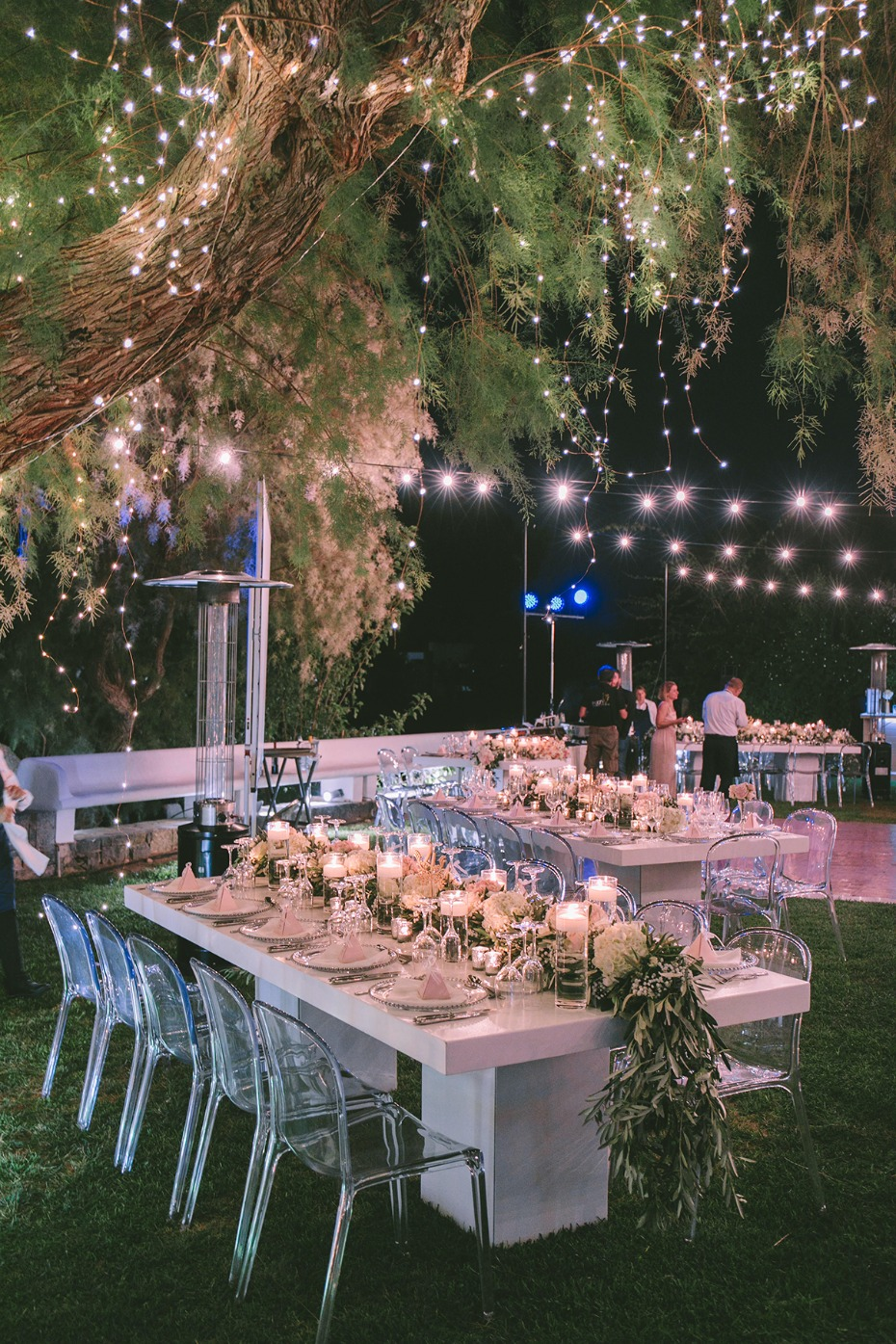 twinkle light and bistro light lit garden reception