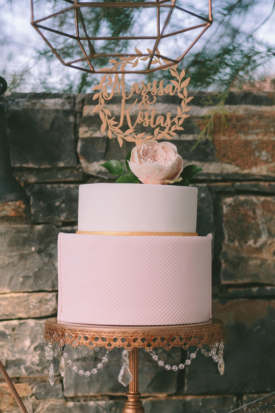 simple soft pink and gold wedding cake