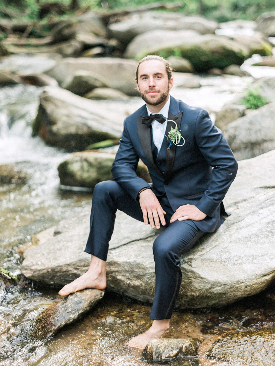 groom in navy and black