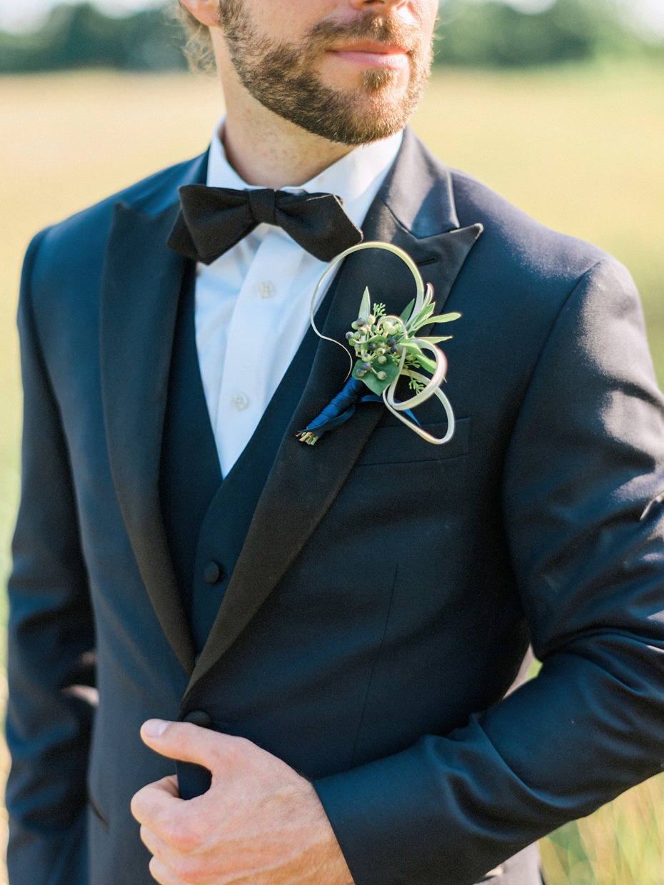 groom in navy and black wedding suit