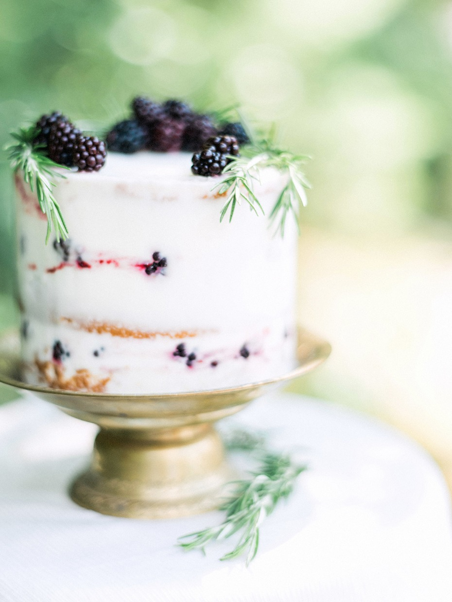 mini wedding cake topped with berries