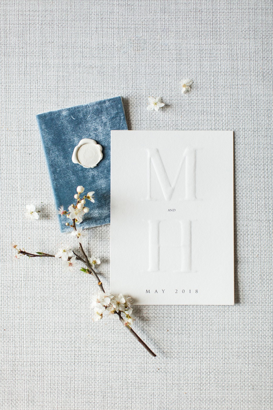 wedding invitations with embossed monogram