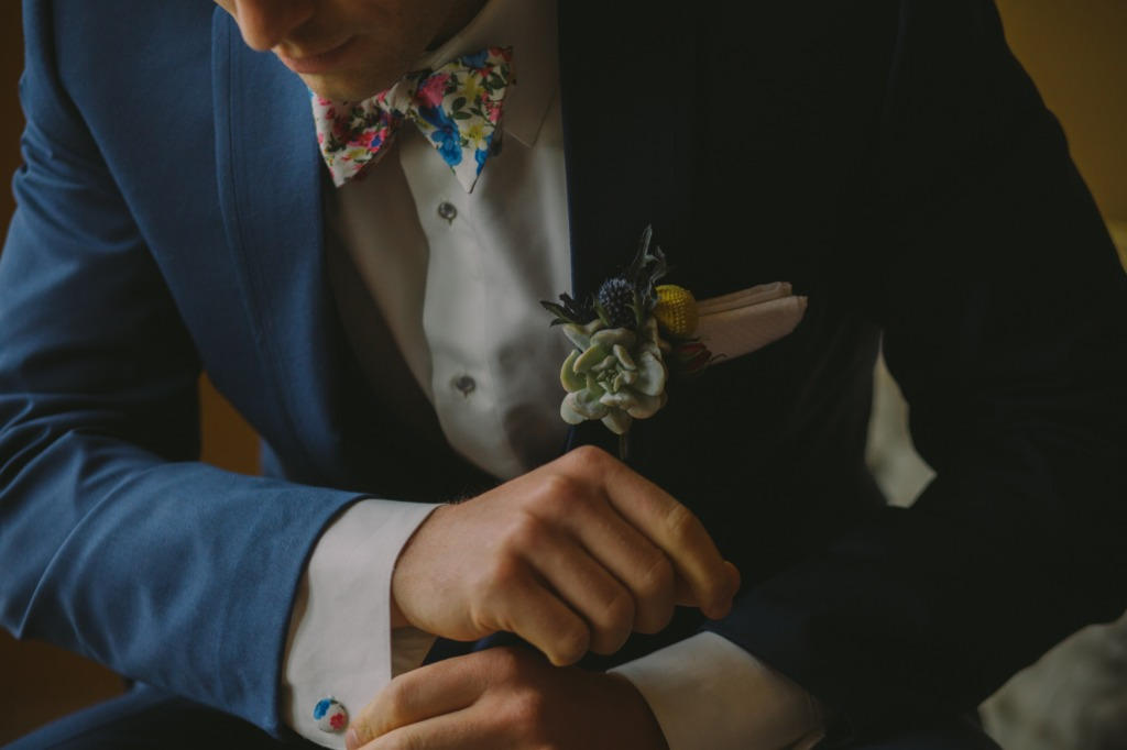 This bow tie and cufflink set adds a pop of color and personality to the groom's attire.