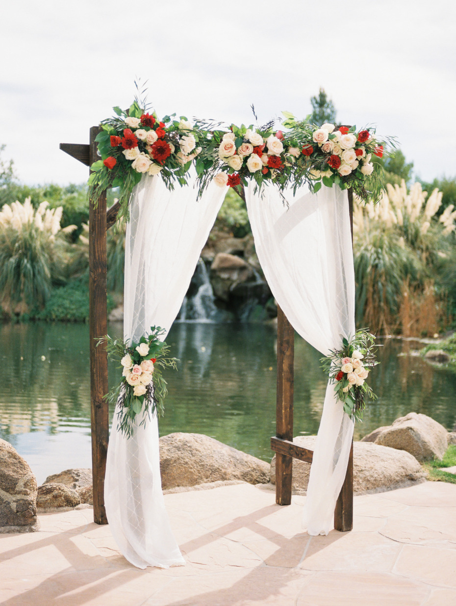 Red and blush ceremony arbor