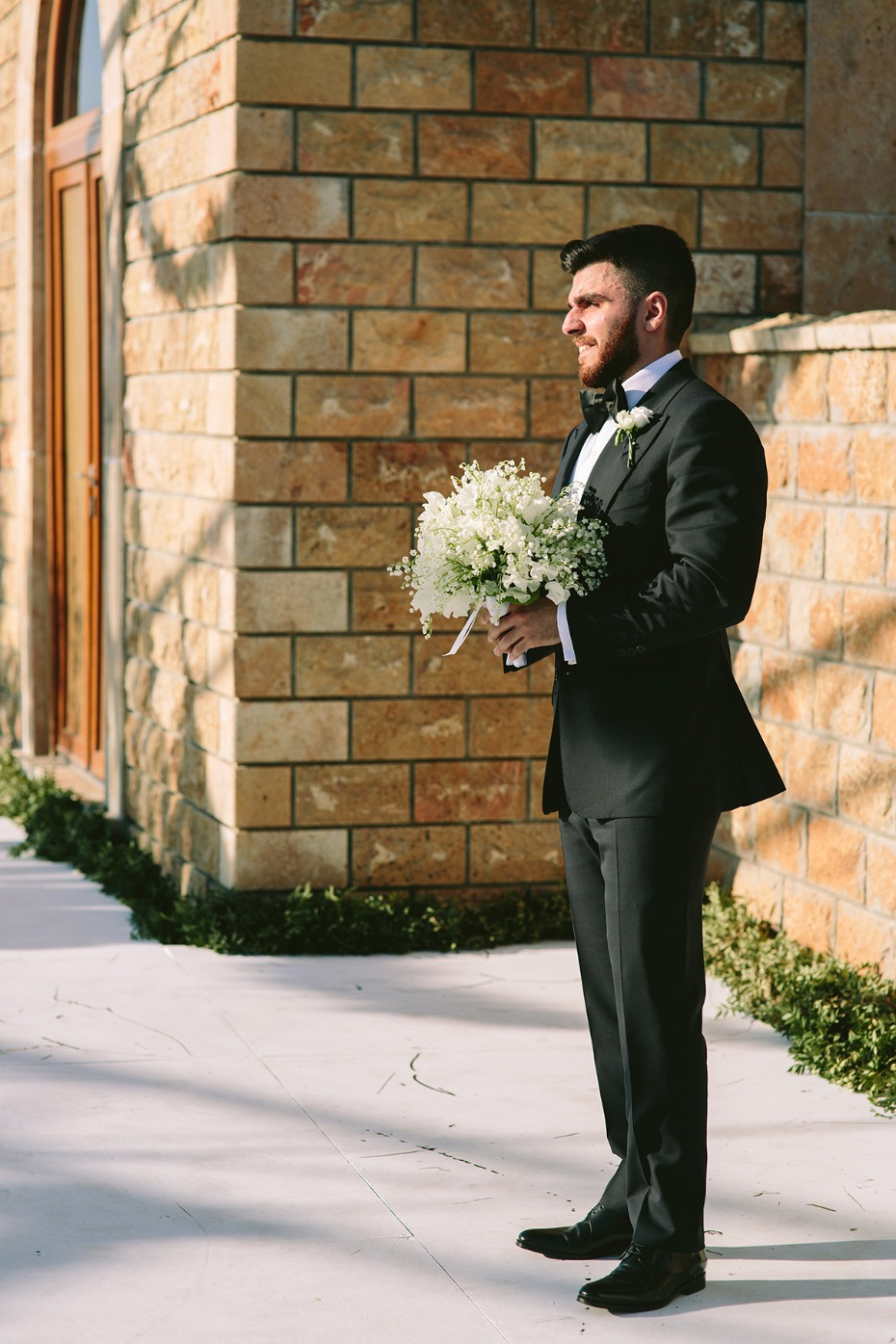 a groom waiting for his bride