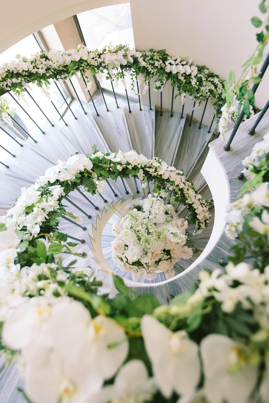 wedding stairs covered in wedding flowers