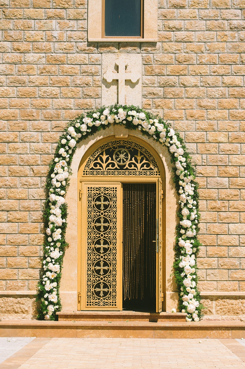 wedding church door with floral arch