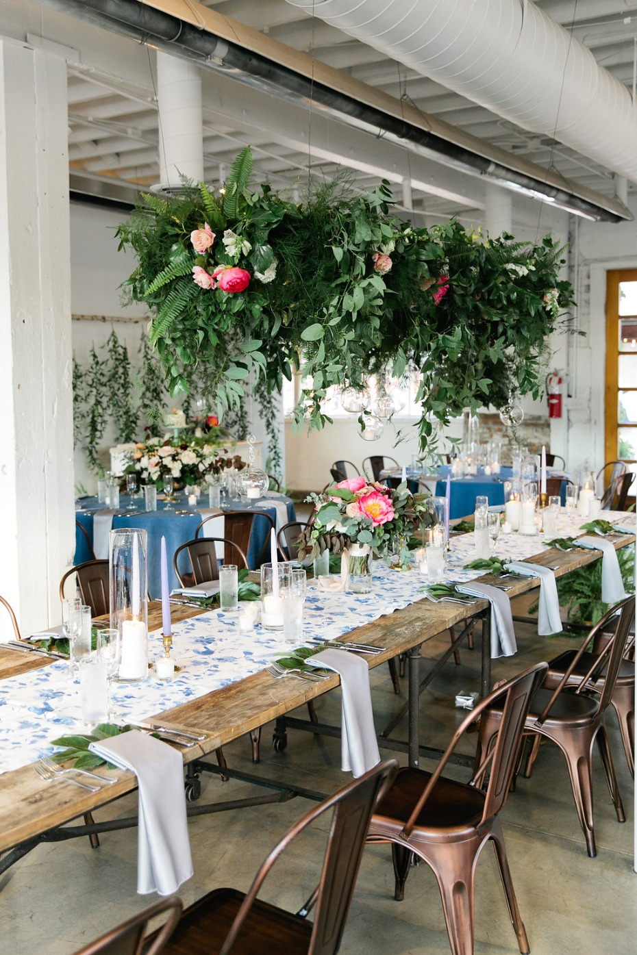 overgrown floral chandelier at wedding head table