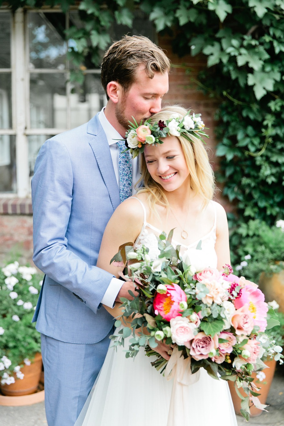 a boho style bride with floral halo