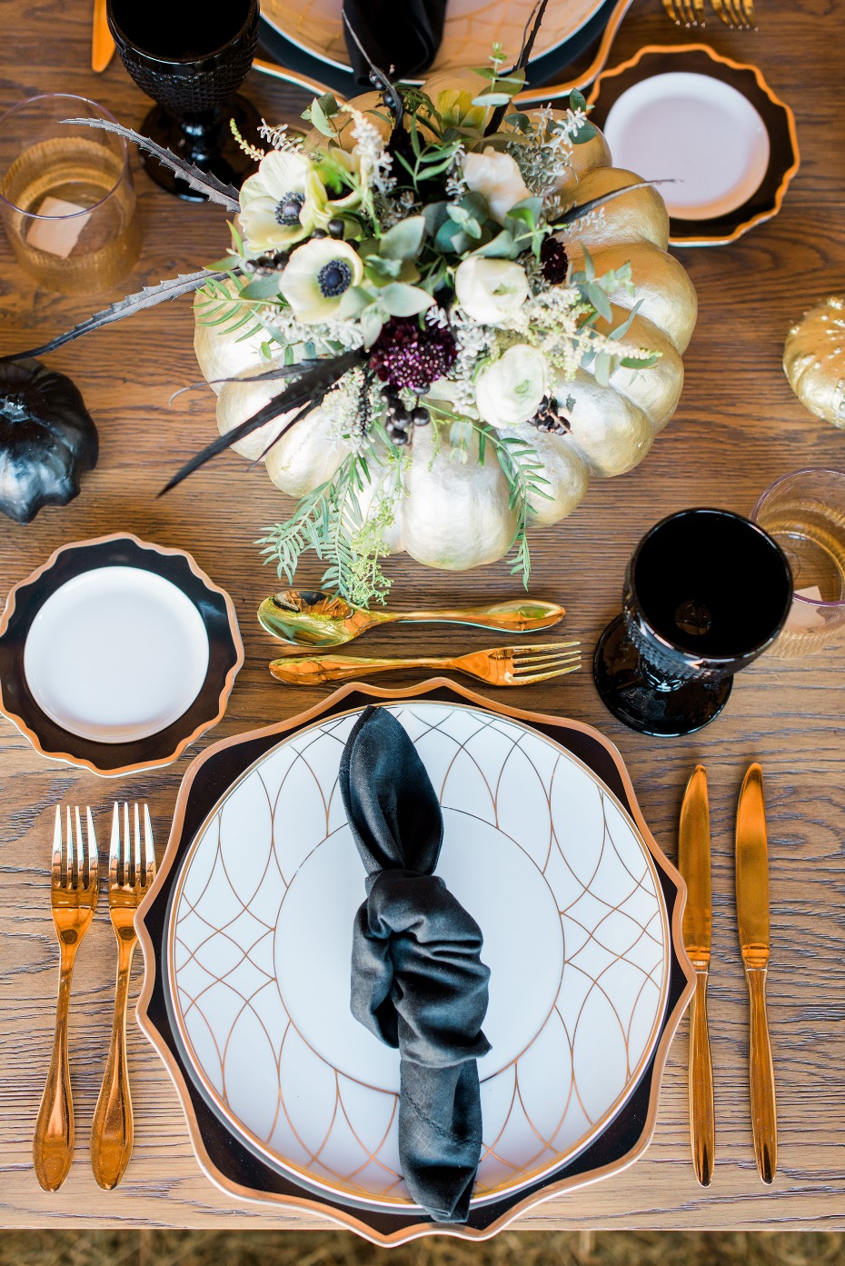 Modern farm table decor in gold, black, and white