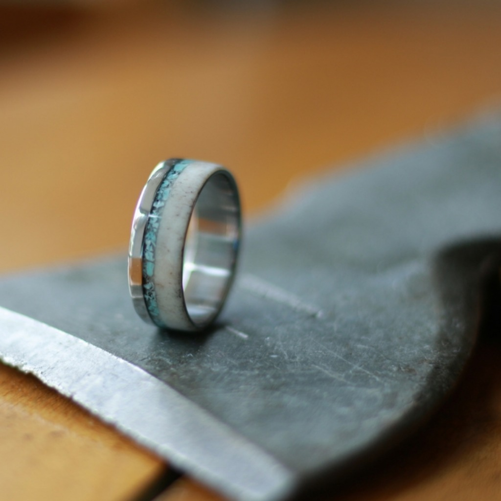 Titanium deer antler ring with crushed stone inlaid through the ring. We can customize these rings however you wish. The perfect men
