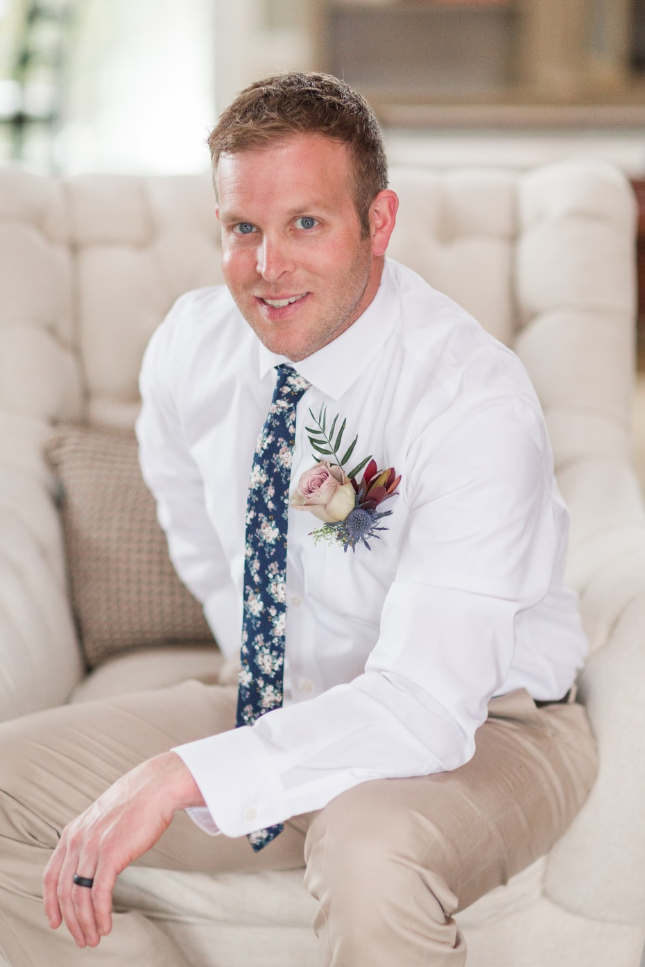 groom in tan pants and floral tie