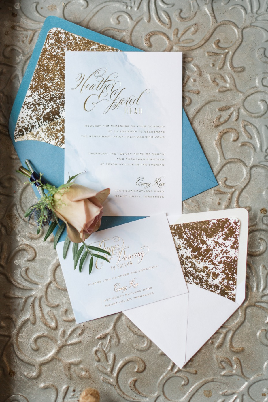 wedding invitations with soft watercolor backdrop